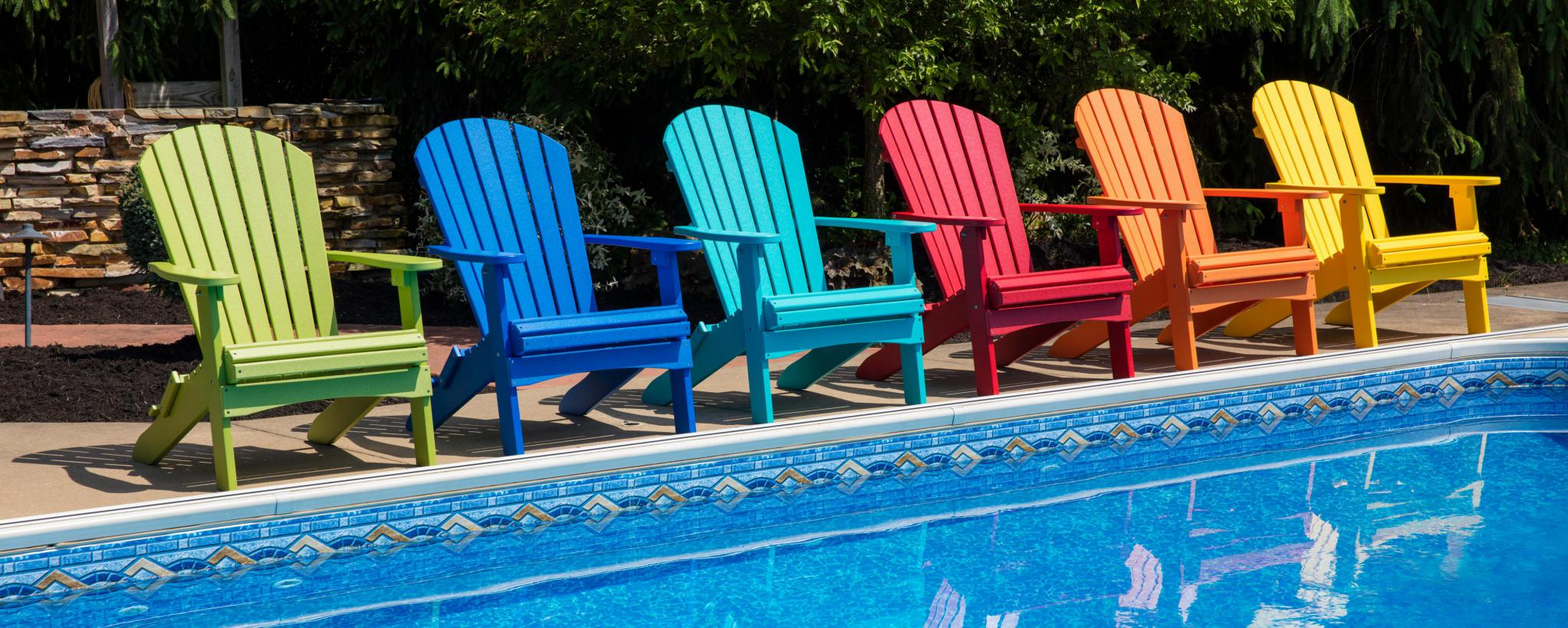 Folding Adirondacks in front of pool