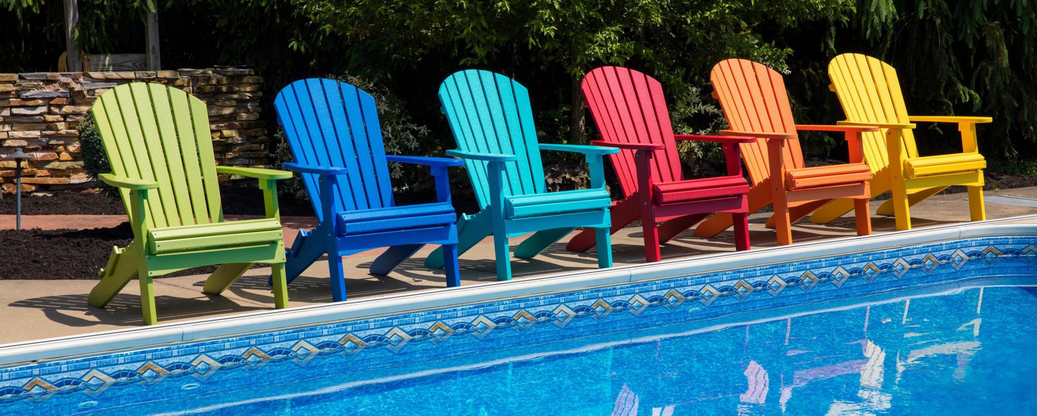 Folding Adirondacks in front of pool