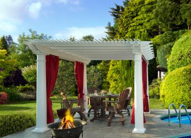 12 x 12 Vinyl Pergola with deluxe shade and round posts. Shown with Dash Crimson curtains